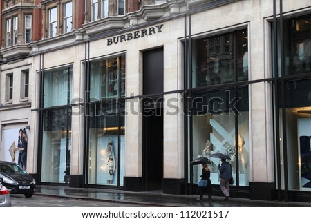 LONDON - MAY 14: Shoppers visit Burberry store on May 14, 2012 in London. Burberry exists since 1856 and has 473 stores. Business Weekly claims Burberry is the 98th most valuable brand worldwide.