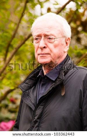 LONDON - MAY 21: Sir Michael Caine at the RHS Chelsea Flower Show in London on May 21, 2012. He is a famous english actor, knighted by Queen Elizabeth II in recognition of his contribution to cinema