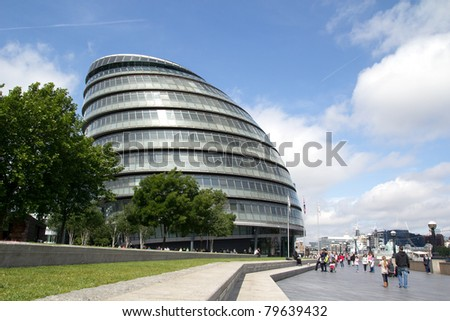 LONDON - MAY 30: The London City Hall Building on May 30, 2011 in London. The building is considered a green building because photovoltaic solar panels were installed on the roof in August 2007. - stock photo