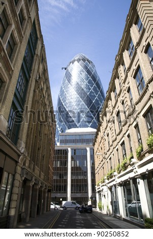 LONDON - MAY 25: The modern glass buildings of the Swiss Re Gherkin on May 25, 2011 in London, England. This tower is 180 meters tall and stands near Liverpool Street Station in City of London.