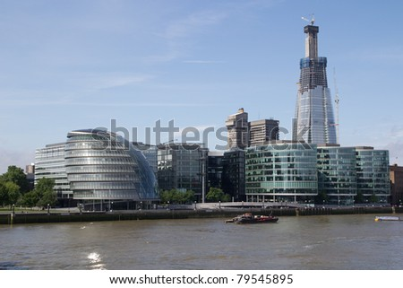 LONDON - MAY 30: The Shard Building (right, in background) under construction on May 30, 2011 in London, England. When completed it will be the tallest building in Europe at 1016 feet (310 meters).
