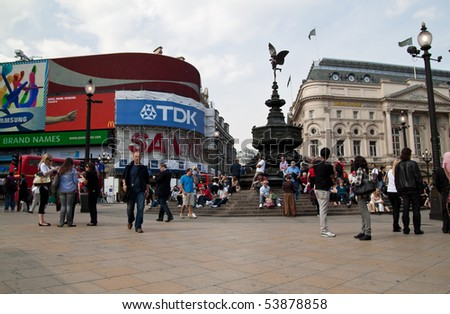 LONDON - MAY 21:Tourists and londoners gather around the statue of Eros at Picadilly Circus May 21, 2010.  A major intersection in London is now a tourist attraction on its own right