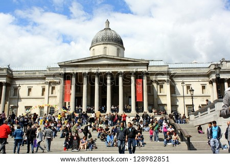 LONDON - MAY 14: Tourists crowd the steps in front of The National Gallery in London on May 14th 2011. The gallery is a top ten destination for visitors to London's galleries and museums.