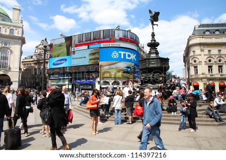 LONDON - MAY 13: Tourists visit Piccadilly Circus on May 13, 2012 in London. With more than 14 million international arrivals in 2009, London is the most visited city in the world (Euromonitor).