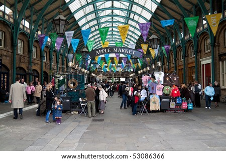 LONDON - MAY 13: Tourists visit the Covent Garden Market May 13, 2010 in London. One of the main London attractions, Covent Garden is visited by over 30 million people a year. - stock photo