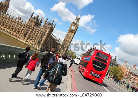 LONDON - MAY 16: Tourists walk towards Big Ben on May 16, 2012 in London. With more than 14 million international arrivals in 2009, London is the most visited city in the world (Euromonitor).