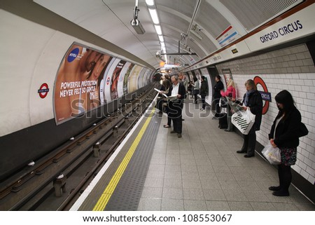 LONDON - MAY 14: Travelers wait at Oxford Circus underground station on May 14, 2012 in London. London Underground is the 11th busiest metro system worldwide with 1.1 billion annual rides.