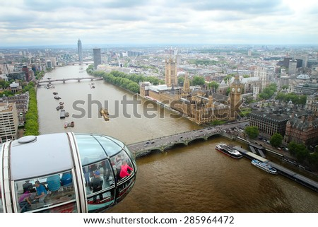 LONDON - MAY 22: View at Detail of London Eye\'s cabins from London Eye on May 22, 2015 in London. With height of 135 meters, it is the highest ferris wheel in Europe.