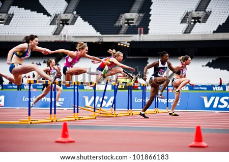 LONDON - MAY 6: women's 100m hurdles at the London prepares series at the Olympic park in London on May 6, 2012. The London Prepares series is the official London 2012 sports testing programme. - stock photo
