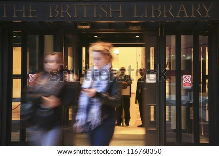 LONDON - NOV 1 : People coming out of British Library building, national library of the UK, designed by professor Colin Wilson, separated from British Museum in 1973 on November 1, 2010, London, UK.