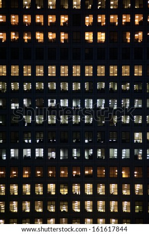 LONDON - NOV 1: people work in an office building in London on November 1, 2013. Full-time employees in the UK work longer hours than the EU average, according to the Office for National Statistics.