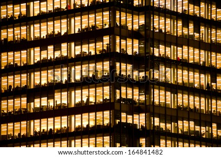 LONDON - NOV 28: people work in an office building in London on November 28, 2013. Full-time employees in the UK work longer hours than the EU average, according to the Office for National Statistics.