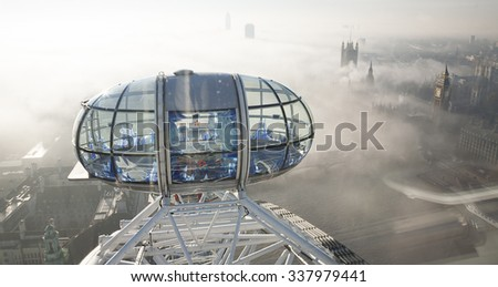 London - November 12, 2013: Bird Eye View, London Eye and Big Ben present,  seen from London Eye, a famous tourist attraction at a height of 135 metres (443 ft) and the biggest Ferris wheel in Europe.