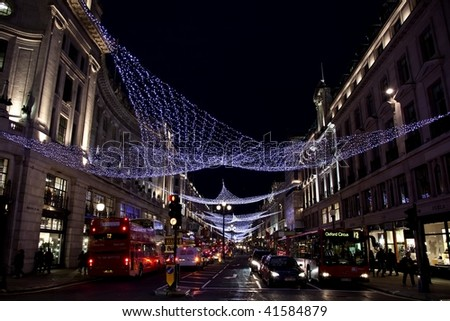 LONDON - NOVEMBER 22: Christmas lights on Oxford street, the busiest shopping area, on November 22, 2009 in London, England