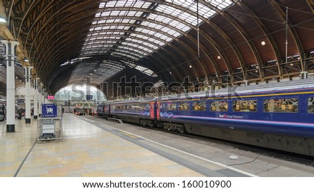 LONDON - OCT 8: A train pulls into Paddington station on Oct 8, 2012 in London, UK. Paddington station is one of the busiest in Europe with more than 100 trains per hour during peak times.