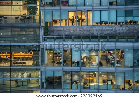 LONDON - OCT 27: people work in an office building in London on October 27, 2014. Full-time employees in the UK work longer hours than the EU average, according to the Office for National Statistics.