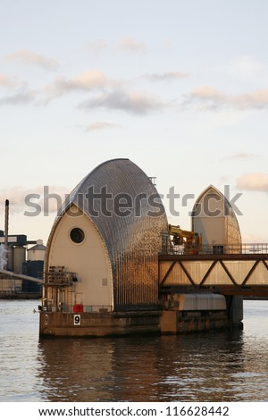 LONDON - OCT 6 : Thames Barrier, tidal protector, commissioned by the Greater London Council, was complete by 1982, the world's second largest movable flood barrier, on Oct 6, 2012 in London, UK.