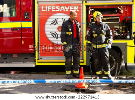 LONDON - OCTOBER 11TH: The fire brigade attend an emergency in waterloo on October 11th, 2014 in London, England, UK. London\'s fire and rescue service is the busiest in the country