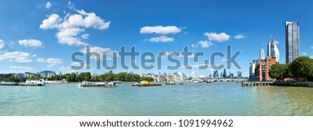 London, panoramic view over Thames river with London skyline on a bright day in Summer