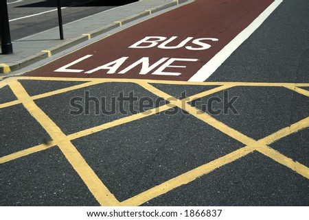 London. Road in  the city. Sectoring for buses and pedestrians. Red, white and yellow lines. #1866837