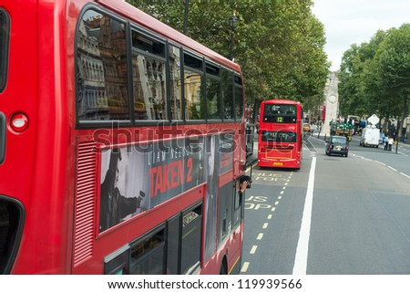 LONDON - SEP 29 : Red Double Decker Bus in the streets of London on September 29, 2012 in London, UK. These buses are the most iconic symbol of London as well as Cabs and Taxis