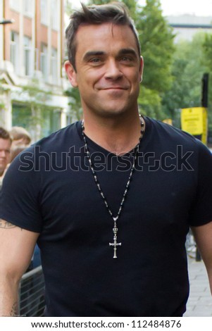 LONDON SEPT 10 Robbie Williams visits BBC Radio One Sept 10 2012 in London UK