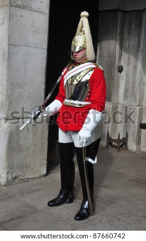 LONDON – SEPTEMBER 24: An unidentified Royal Cavalry is on guard at the Horse Guard Buildings on September 24, 2011 in London, England. The Queens Cavalry was formed more than 130 years ago.