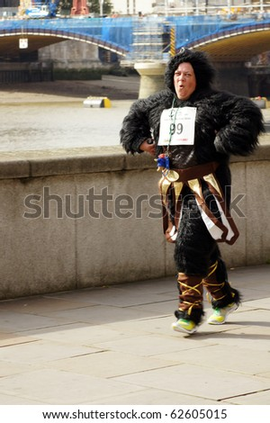 LONDON - SEPTEMBER 26: Runners participating in The 2010 Great Gorilla Run held September 26, 2010 by the River Thames in London, England.