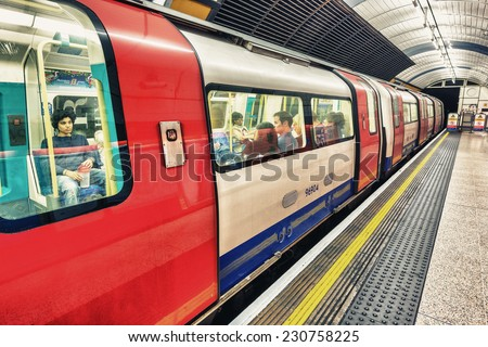LONDON - SEPTEMBER 28, 2013: Subway train in underground station. London subway system serves 270 stations and has 402 kilometres (250 mi) of track.
