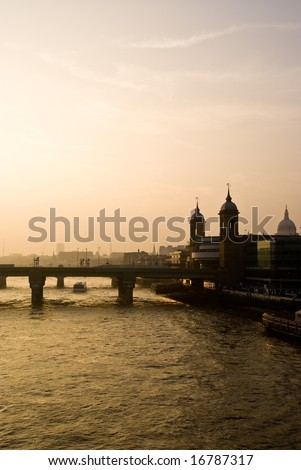 London skyline on the river thames at sunset.