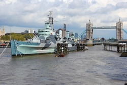 London skyline, UK. Thames river cityscape with HMS Belfast monument warship and Tower Bridge.