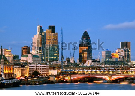 London Skylines Skyscrapers along River thames at dusk England UK