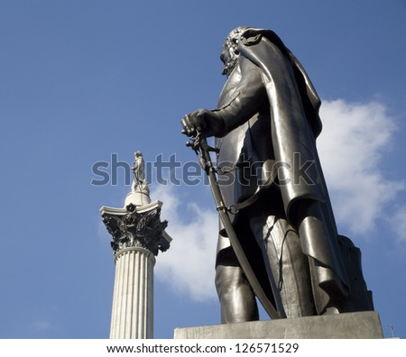 London - statue of general and Admiral Nelson memorial from Trafalgar square in background
