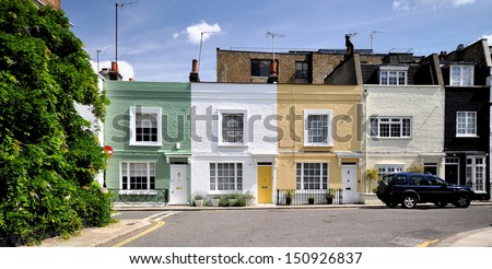 London street of small terraced houses.