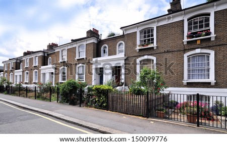London street of typical small 19th century Victorian terraced houses without parked cars.
