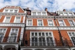 London street of upmarket residential red brick buildings in Kensington