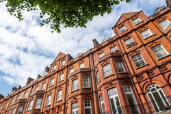 London street of upmarket residential red brick houses in Kensington