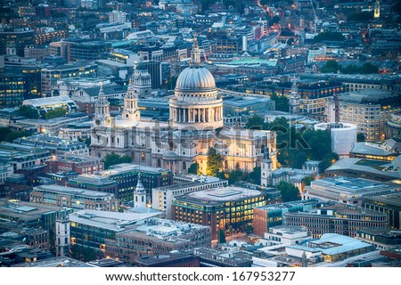 London. Stunning aerial view of St. Paul Cathedral and city skyline at dusk.