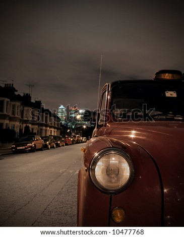 London taxi parked on residential street