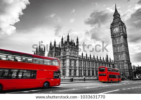London, the UK. Red buses in motion and Big Ben, the Palace of Westminster. The icons of England in vintage, retro style. Red in black and white #1033631770