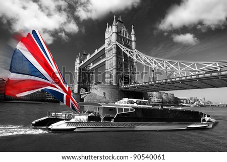 London Tower Bridge with colorful flag of England on city cruise