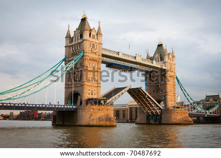 London Tower Bridge with open gates at sunset