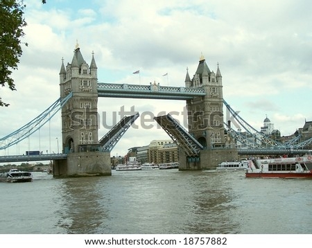 London, Tower Bridge with suspended bascules open over river Thames in London