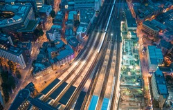 London. Train station and Tower Bridge night lights, aerial view.