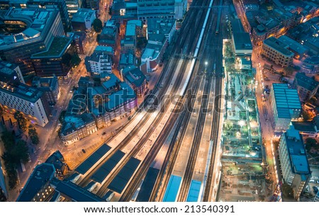 London. Train station and Tower Bridge night lights, aerial view. #213540391