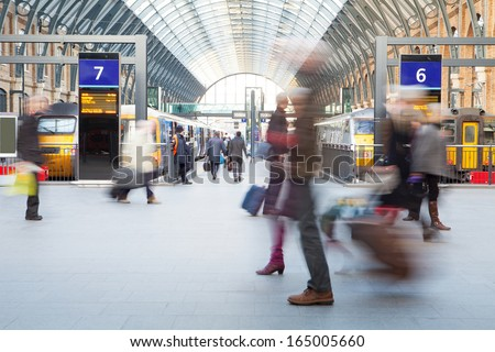 London Train Tube station Blur people movement in rush hour, at King\'s Cross station, England, UK