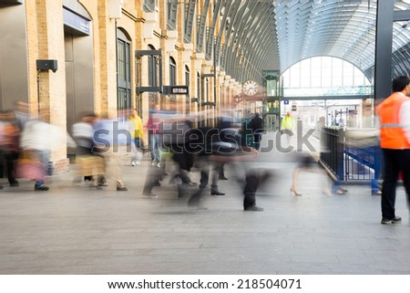 London Train Tube station Blur people movement in rush hour at King\'s Cross station, England, UK