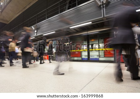London tube train station people movement in rush hour
