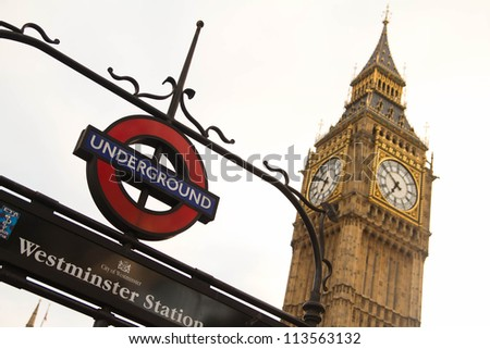 LONDON, UK - APR 12: London Westminster underground station with Big Ben in the background on April 12, 2012 in London. - stock photo
