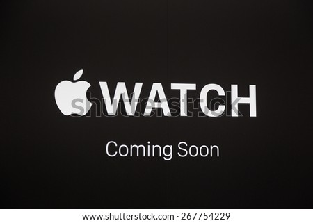 LONDON, UK - APRIL 08, 2015: Apple Watch store sign at Selfridges in Oxford street with people walking on sidewalk. It will be one of first three official stores in the world, opening on April 10th.